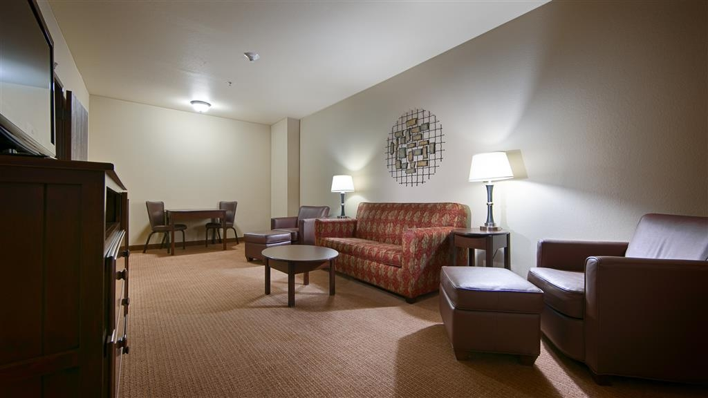 Best Western Plus Cimarron Hotel & Suites - This king suite includes a separate living area with a flat screen TV and sofa bed.
