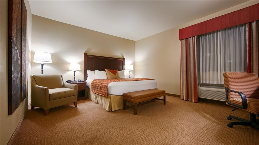 Best Western Plus Cimarron Hotel & Suites - Our guest room features a desk with chair, refrigerator, and microwave.