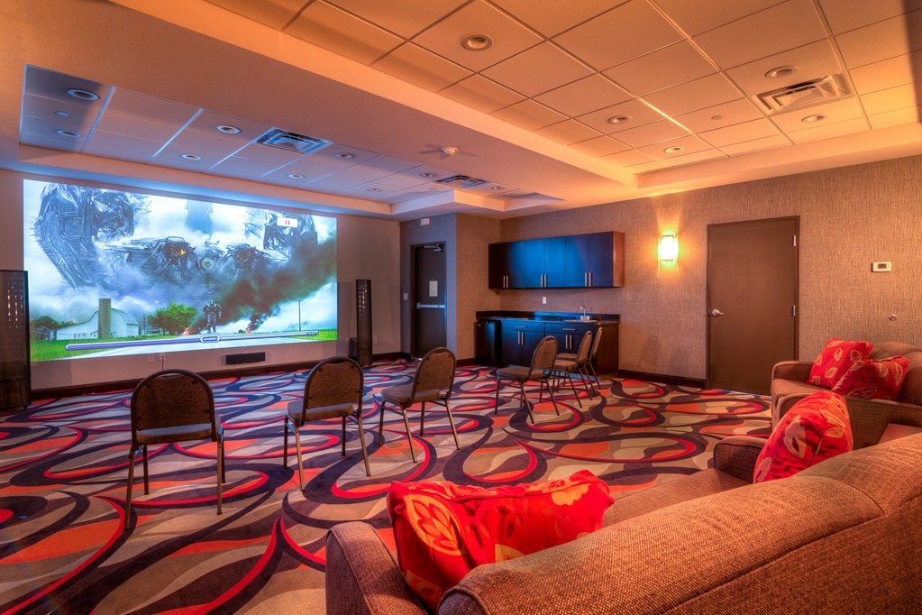 Best Western Plus Coweta's 1st Hotel - Our theater room has a state of the art sound system and an 180-inch HD screen that rivals actual movie theaters. An affordable family movie night.