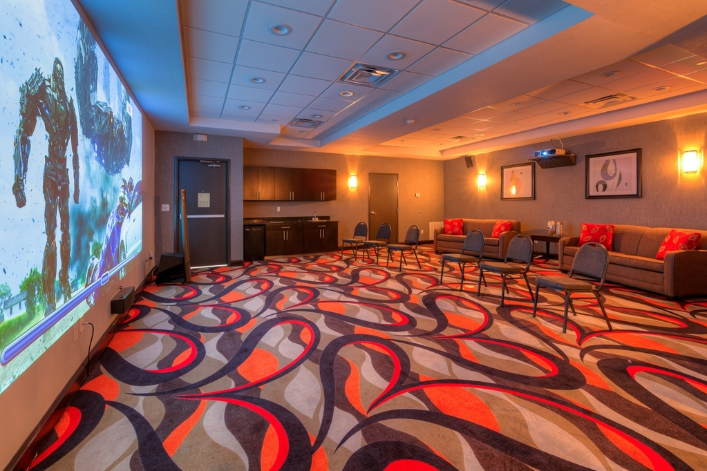 Best Western Plus Coweta's 1st Hotel - Our theater room is large enough for 35 guests to enjoy movies, sports or even YouTube or Netflix on our 180-inch HD screen.