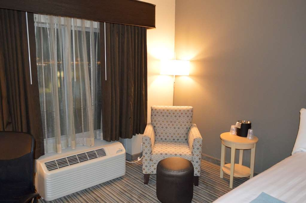 Best Western Plus Norman - The sitting areas in our rooms provide the perfect place to sit and relax during your stay.