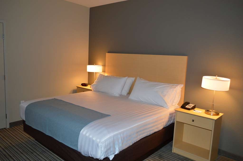 Best Western Plus Norman - Sleep in a plush king bed and enjoy a good night's rest in one of our guest rooms.