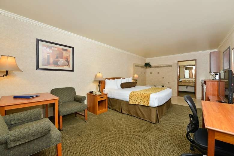 Best Western Holiday Hotel - Book our king bed and relax the night away in our in-room whirlpool spa.