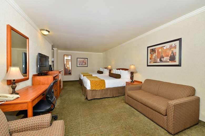 Best Western Holiday Hotel - Our two queen beds and sofa bed guest room is spacious and offers you a comfortable place to unwind.