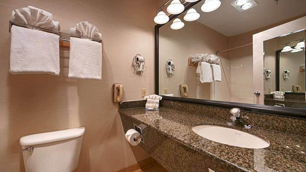 Best Western Plus Ocean View Resort - All guest bathrooms have a large vanity with plenty of room to unpack the necessities.