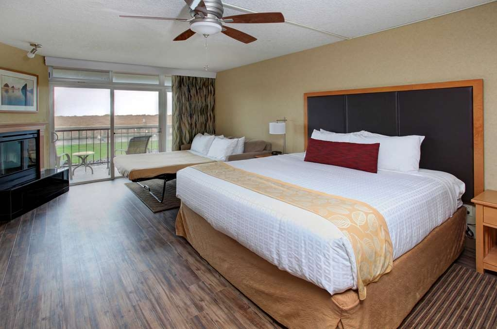 Best Western Plus Ocean View Resort - This room has one king pillow top bed, living room area with sofa sleeper, fireplace and a ground floor patio.