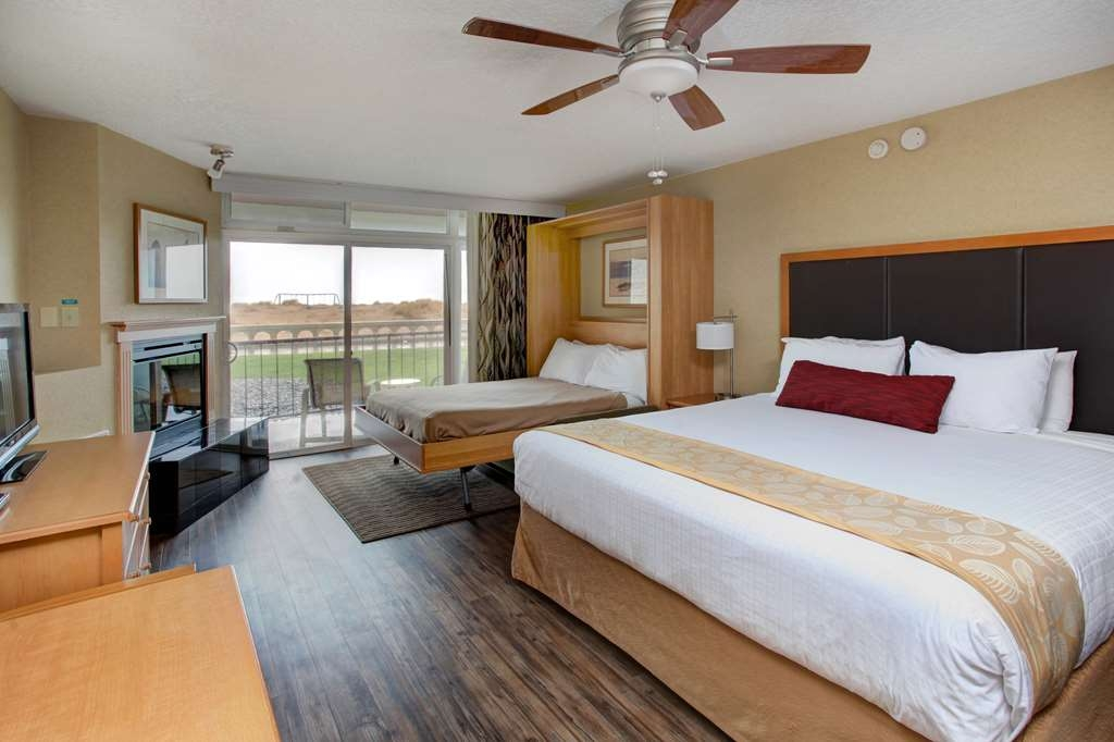 Best Western Plus Ocean View Resort - Our beachfront king & queen rooms feature one king pillow top bed and a pull down wall bed with queen pillow top mattress.