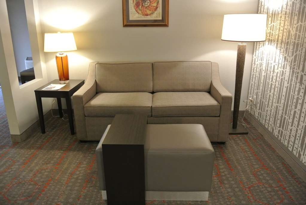 Best Western Corvallis - This is the sitting lounge area with a sofa or a sofa bed and balcony in our corner suite (Suite is approximately 460 square feet).