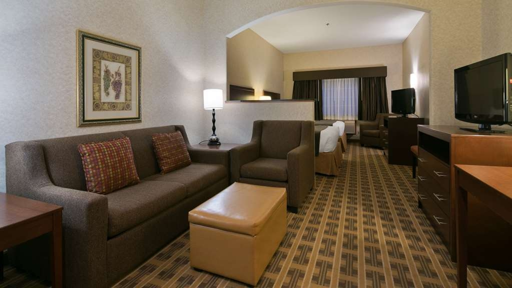 Best Western University Inn & Suites - The living room couch also doubles as a sofa bed.