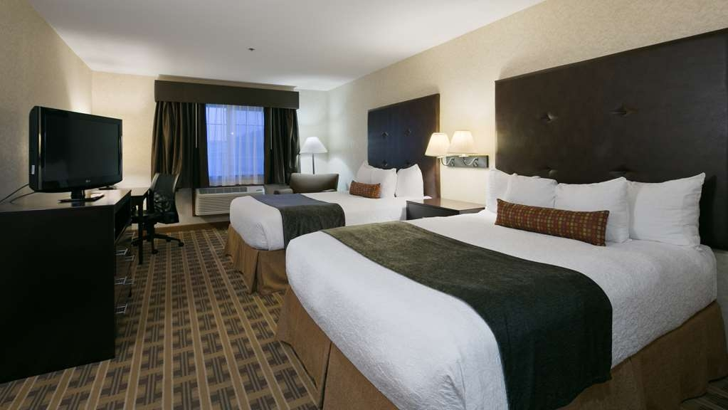 Best Western University Inn & Suites - Our standard two queen room offers same updated bedding and a work area.