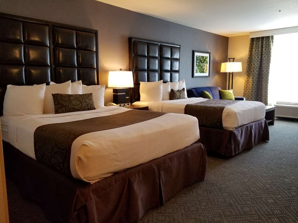 Best Western Plus Northwind Inn & Suites - Our two queen guest room offers the comforts of home with a few added amenities that will make your stay extra special.