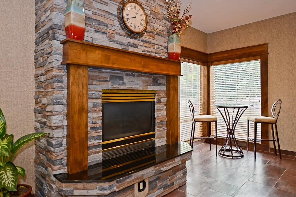 Best Western Plus Prairie Inn - Our lobby features a fireplace to warm you up on those cold days.