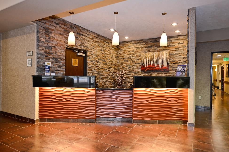 Best Western Plus Prairie Inn - Check in and out with our friendly 24-hour front desk staff.