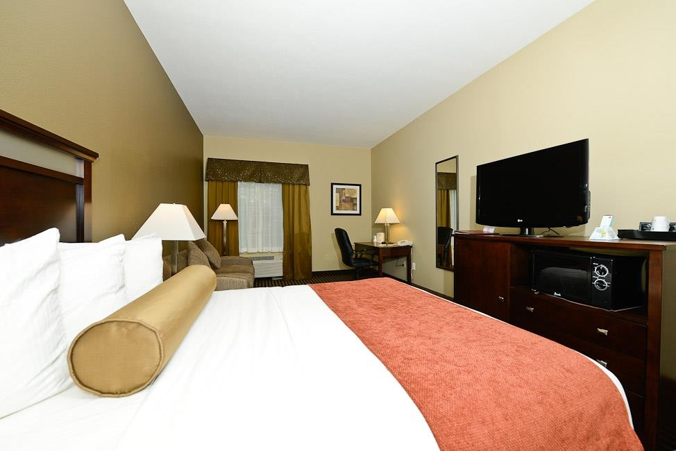 Best Western Plus Prairie Inn - Our king rooms offer a refrigerator, microwave, 40-inch HD TV with HD channels, iron/ironing board, spacious desk and an executive office chair, coffee table and sofa sleeper.