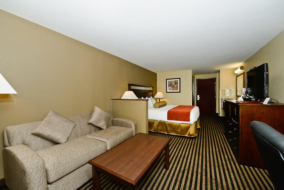 Best Western Plus Prairie Inn - Our standard king guest rooms also features a queen sofabed in the sitting area.