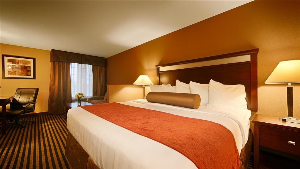 Best Western Plus Prairie Inn - Guest Room with a King size bed, sofa sleeper and coffee table