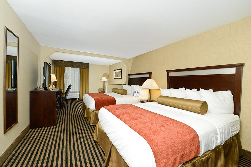 Best Western Plus Prairie Inn - Our double queen rooms offer a refrigerator, microwave, 40-inch HD TV, iron/ironing board, spacious desk and an executive office chair.