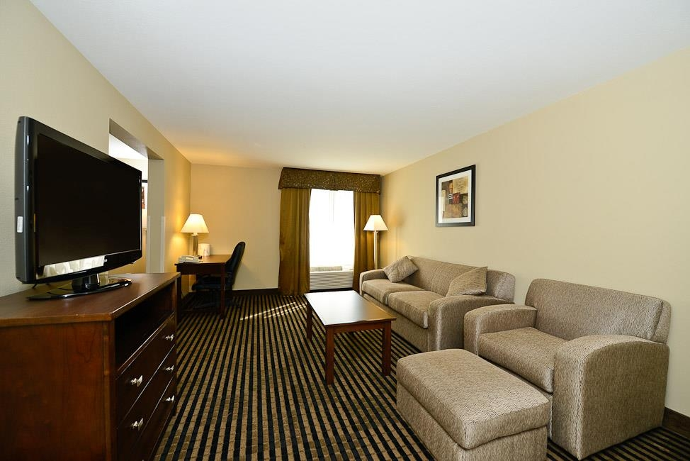 Best Western Plus Prairie Inn - Two Room Double Queen Suite with sofa sleeper, chair and ottoman