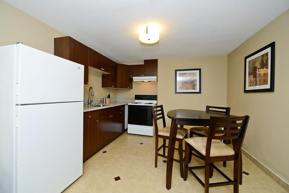 Best Western Plus Prairie Inn - The two room double queen suite includes a full kitchen.