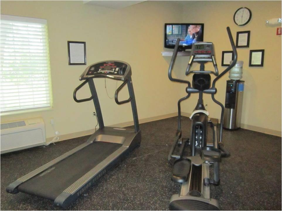 Best Western Plus Prairie Inn - Our fitness center is a popular way to workout while having fun! Enjoy a 37-inch HD TV, bottled water and complimentary towels.