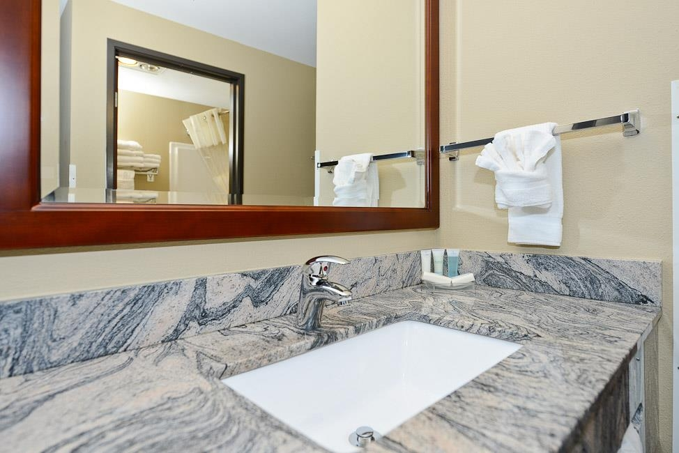 Best Western Plus Prairie Inn - There is a separate granite counter top vanity area, with sink and built-in hairdryer.