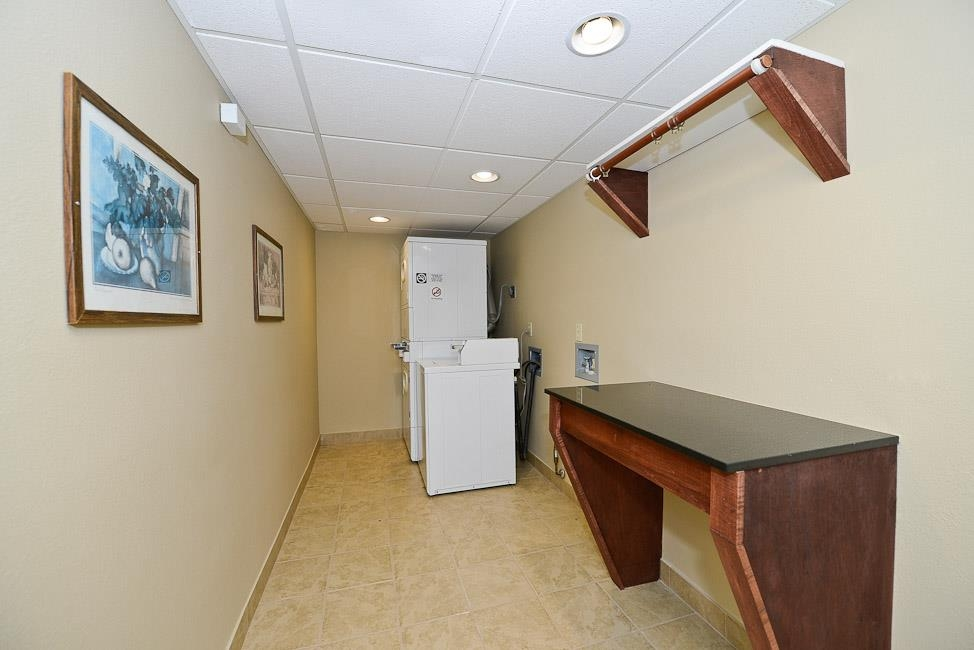 Best Western Plus Prairie Inn - Guest laundry is available 24-hours a day. Laundry room features a soap dispenser and folding table for your convenience.