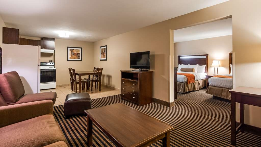 Best Western Plus Prairie Inn - Two Queens Suite with full size kitchen Living Room
