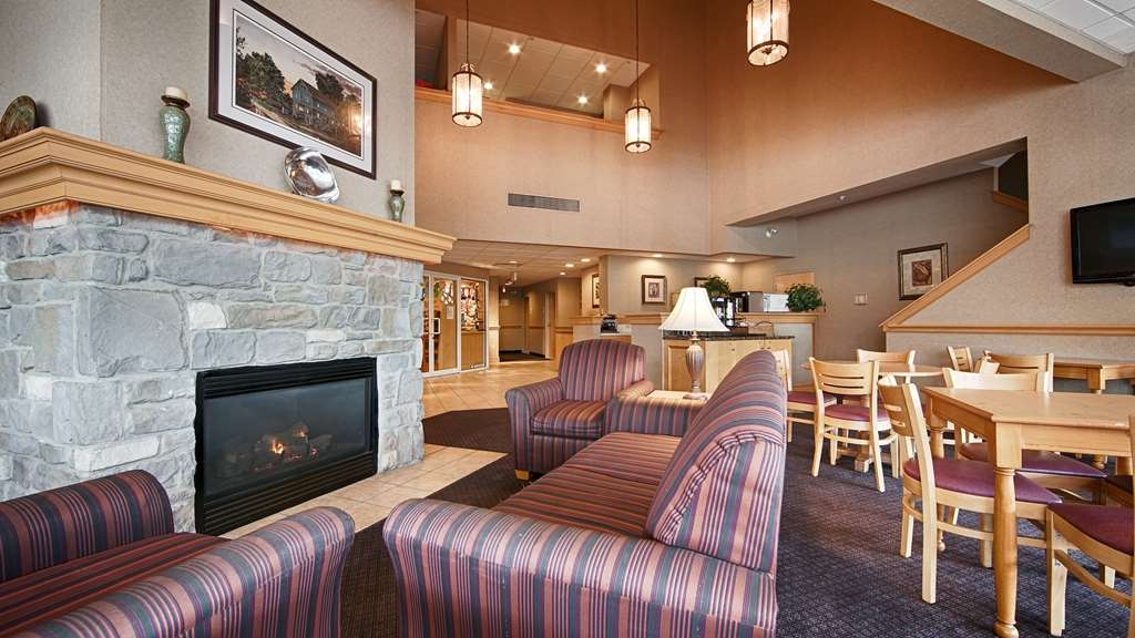 Best Western Plus Revere Inn & Suites - Cozy up by the fireside in our warm and welcoming lobby.