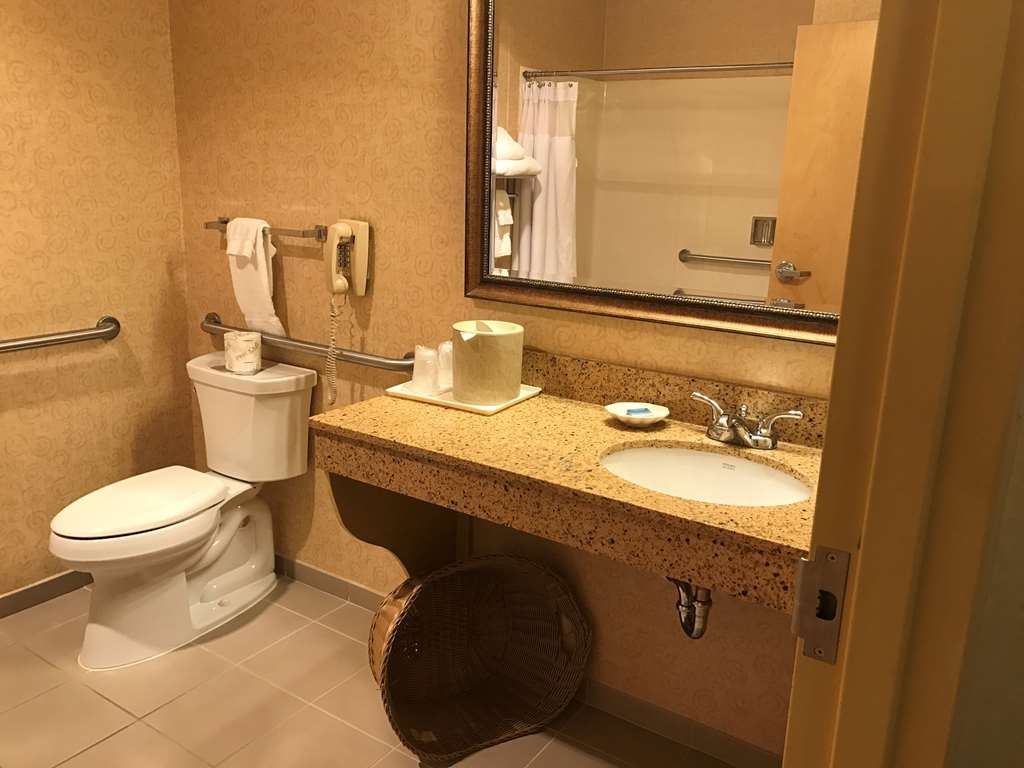 Best Western Plus Revere Inn & Suites - ADA mobility accessible bath area. Located in the main building with interior corridors. Room includes refrigerator.