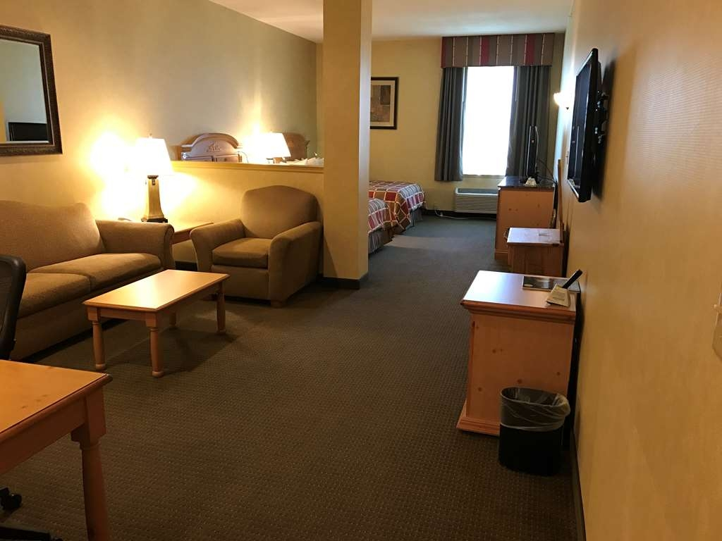 Best Western Plus Revere Inn & Suites - Our Family Suite in the main building is oversized with 2 queen beds and queen size sofa bed featuring 2 flat screen televisions.