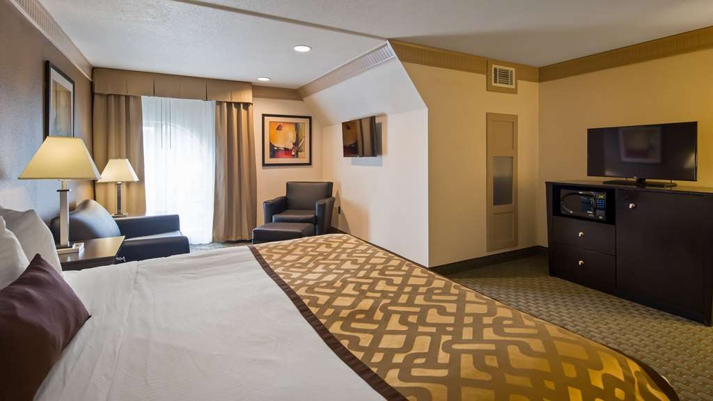 Best Western Plus Concordville Hotel - Executive King guest room with on king bed and a pull out sofa bed.