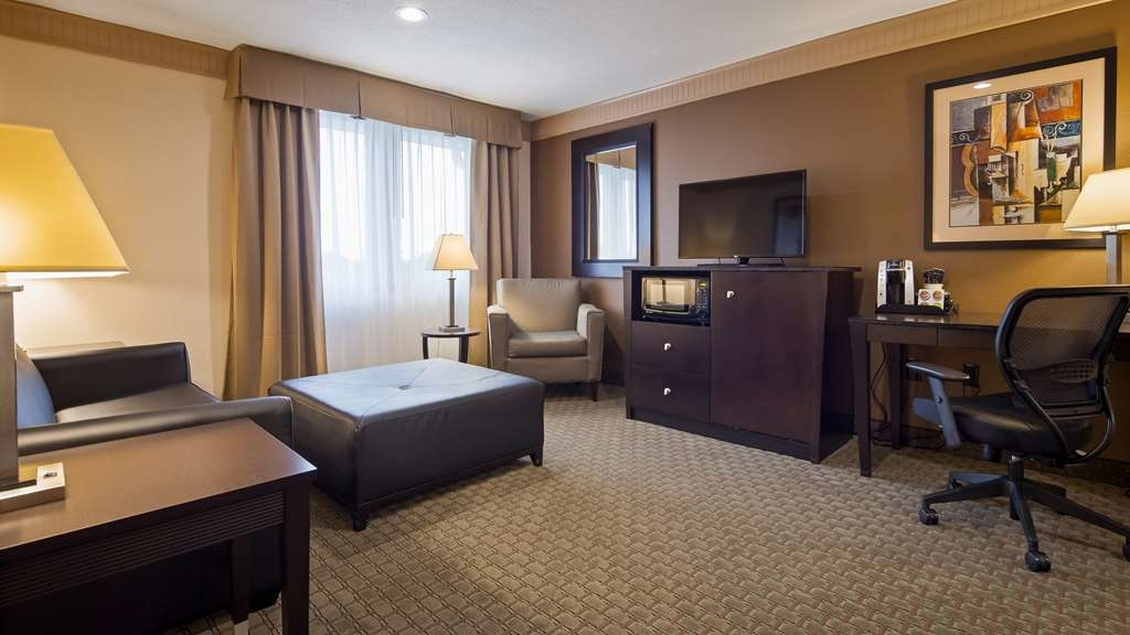 Best Western Plus Concordville Hotel - King Suite living room with pull out sofa bed.