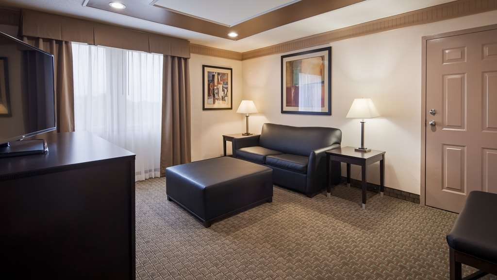 Best Western Plus Concordville Hotel - 3 Room Family Suite features a Living Room with pull out sofa bed, One King Bedroom, One full bedroom and two full bathrooms.