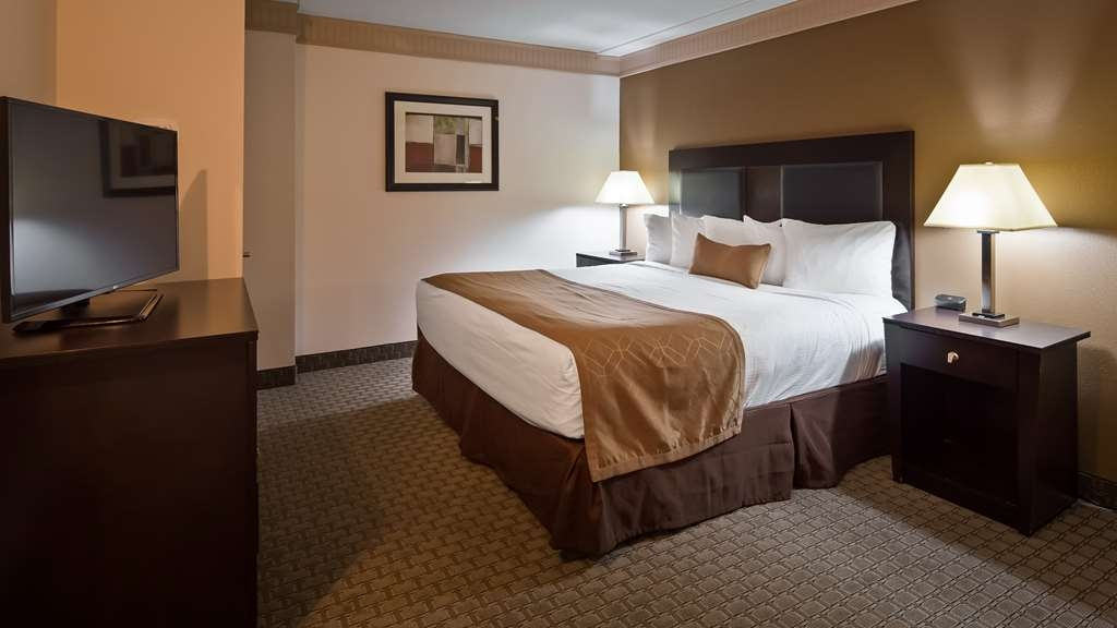 Best Western Plus Concordville Hotel - Presidential King Suite with one king bed.