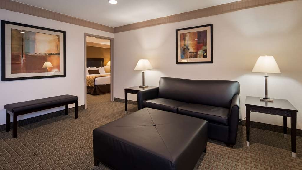 Best Western Plus Concordville Hotel - Premium King Suite living room with pull out sofa bed.