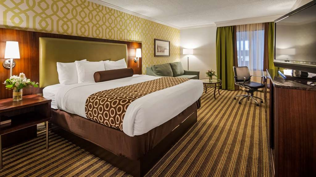 Best Western Premier The Central Hotel & Conference Center - This spacious room features a king-sized bed, desk, and a sitting area with a convenient queen-sized sleeper sofa. All guest rooms are complete with a 42