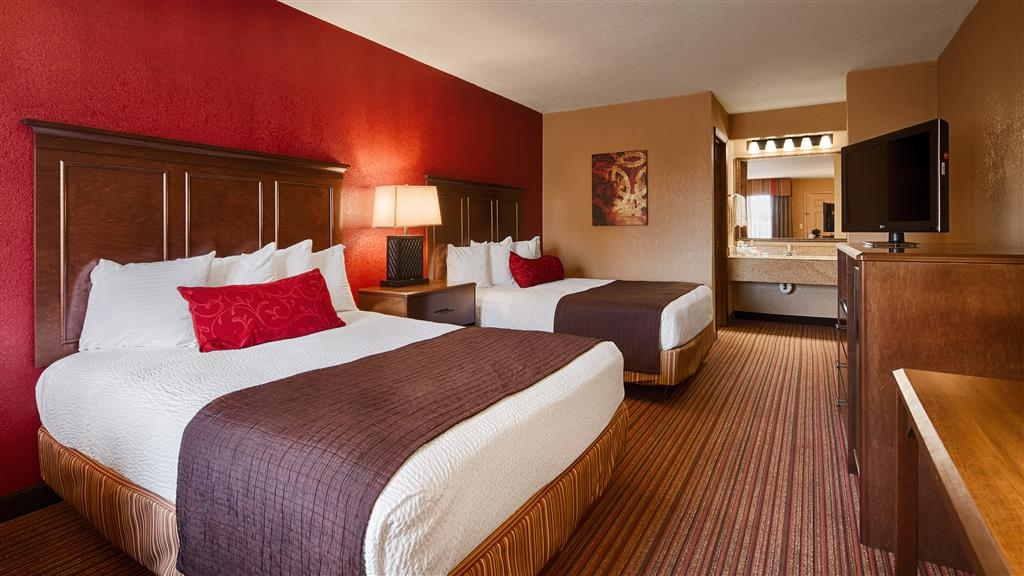 Best Western Inn - Room features two cozy queen beds and is equipped with a microwave and refrigerator.