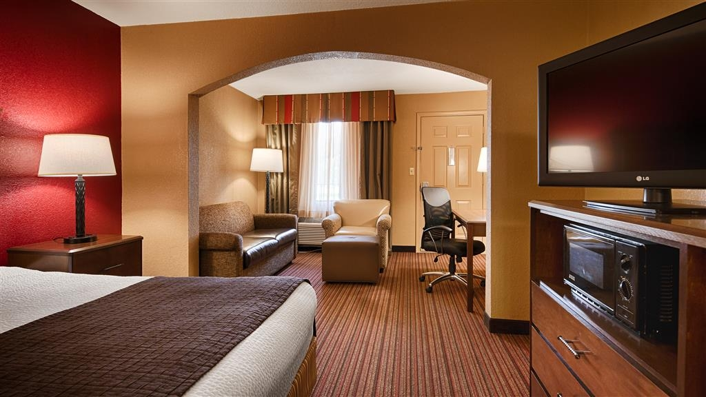 Best Western Inn - Our king deluxe room is furnished with a work area as well as a microwave and refrigerator.