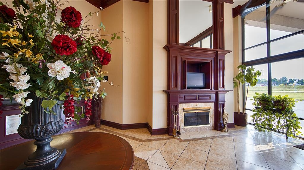 Best Western Windsor Suites - Stay warm by the fireplace or settle into one of the comfortable chairs.