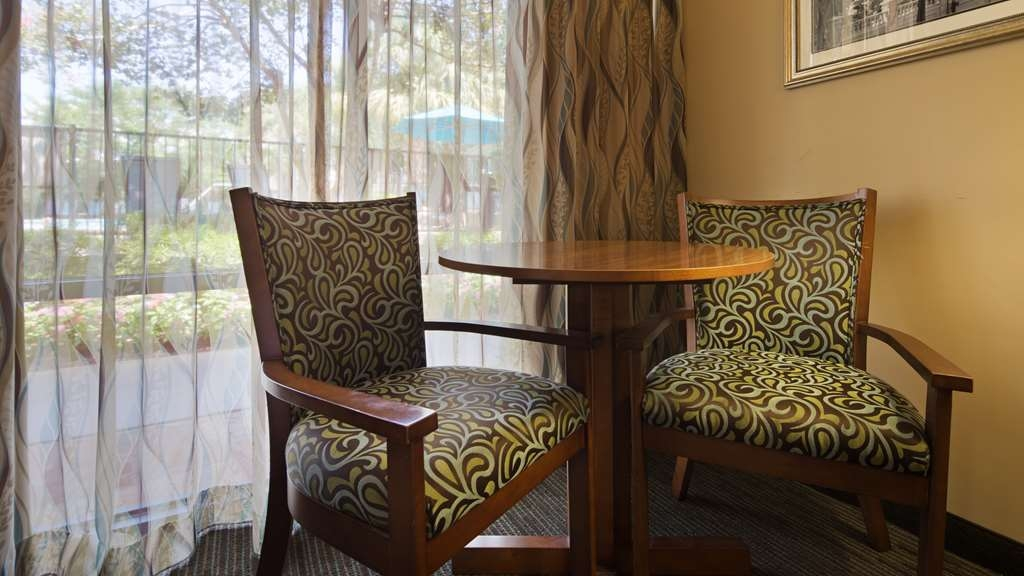Best Western Charleston Inn - Many of our deluxe rooms feature a seating area looking over our pool area.