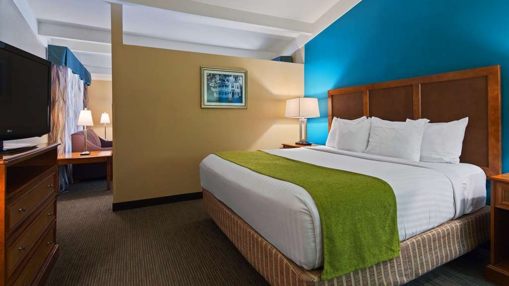 Best Western Charleston Inn - Our suite features a separate seating area and bedroom.