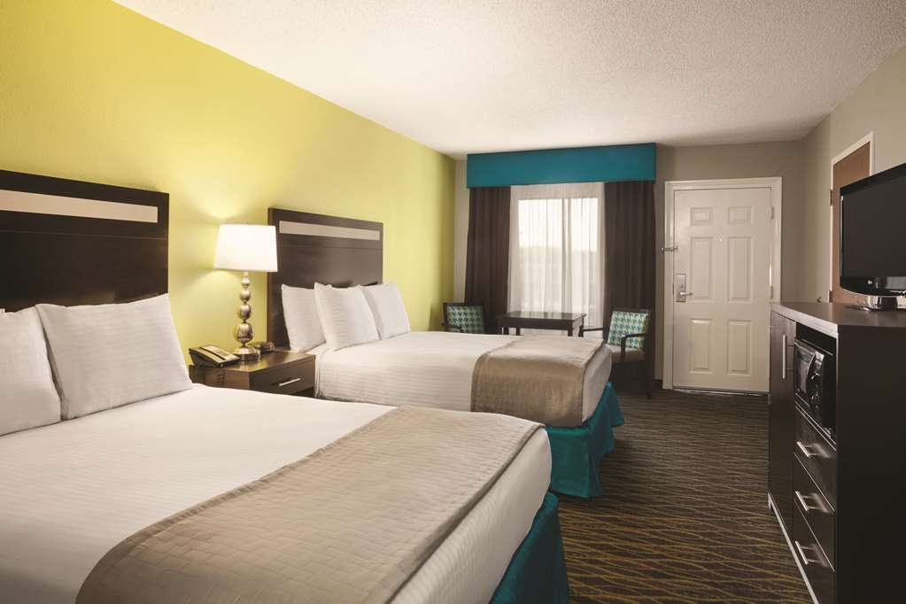 Best Western Inn - Pull back the covers, hop in and catch your favorite TV show in our two queen guest room.
