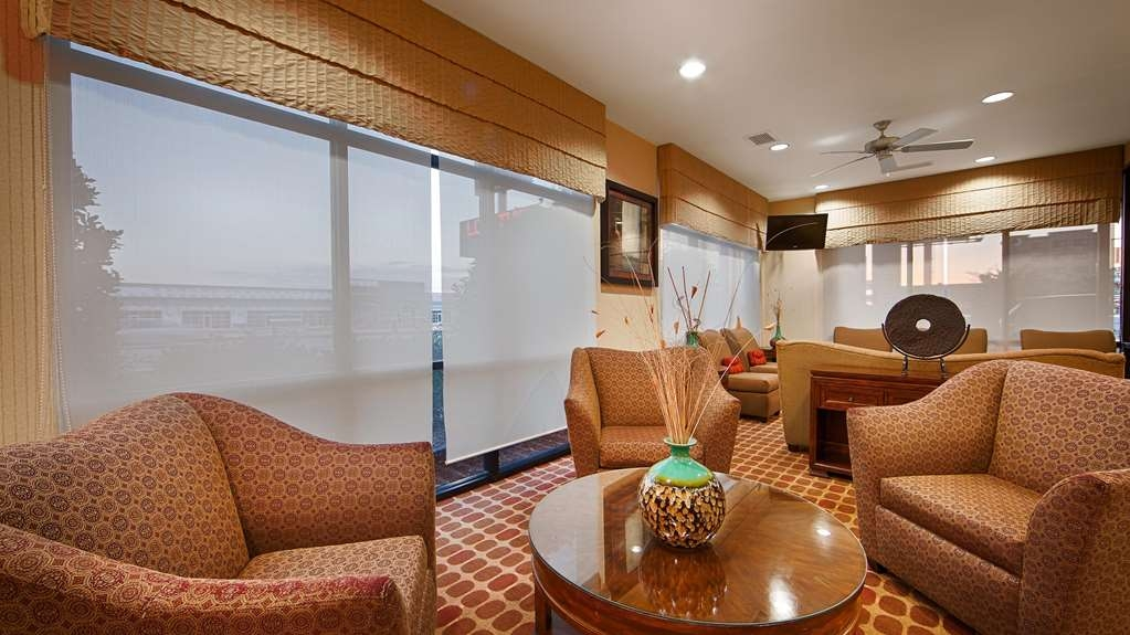 Best Western Plus Castlerock Inn & Suites - Our lobby is the perfect spot to relax after a long day of work and travel.