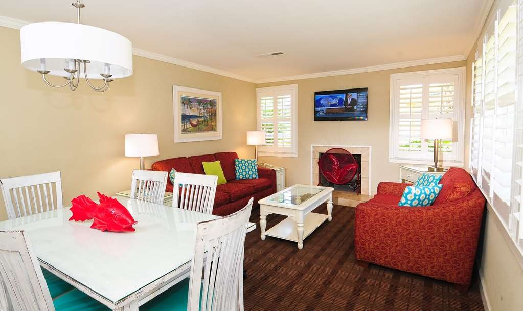 Best Western Plus Grand Strand Inn & Suites - The ocean view two bedroom penthouse, features a living room with a 37-inch LCD TV, overstuffed chairs and a queen size sleeper sofa.