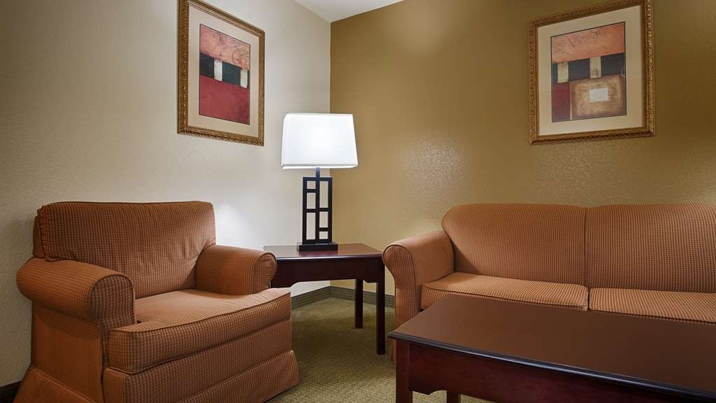 Best Western Sherwood Inn & Suites - Our spacious king suite guest room is complete with a sitting area and a desk/work area.