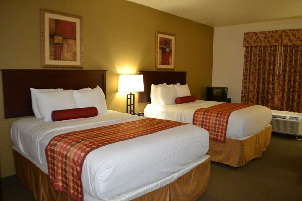 Best Western Sherwood Inn & Suites - Spacious guest room with two queen beds includes a microwave fridge and coffee pot.