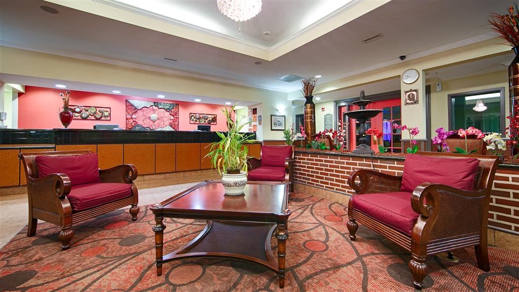 Best Western Plus Airport Inn & Suites - Our hotel lobby area offers a relaxing place to read a book or socialize with colleagues and friends.