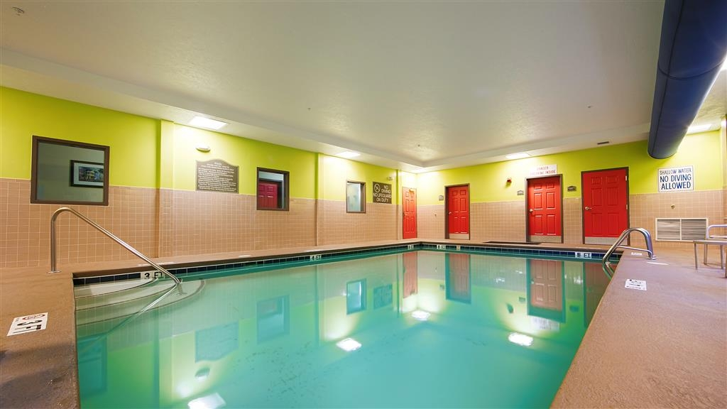 Best Western Plus Airport Inn & Suites - Don't let the weather stop you from jumping in! Our indoor pool is heated year-round for you and your friends.