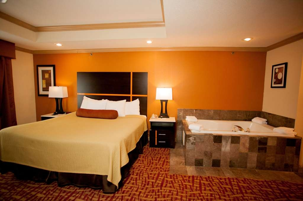 Best Western Aspen Hotel - Our Presidential Suite features a in jacuzzi.