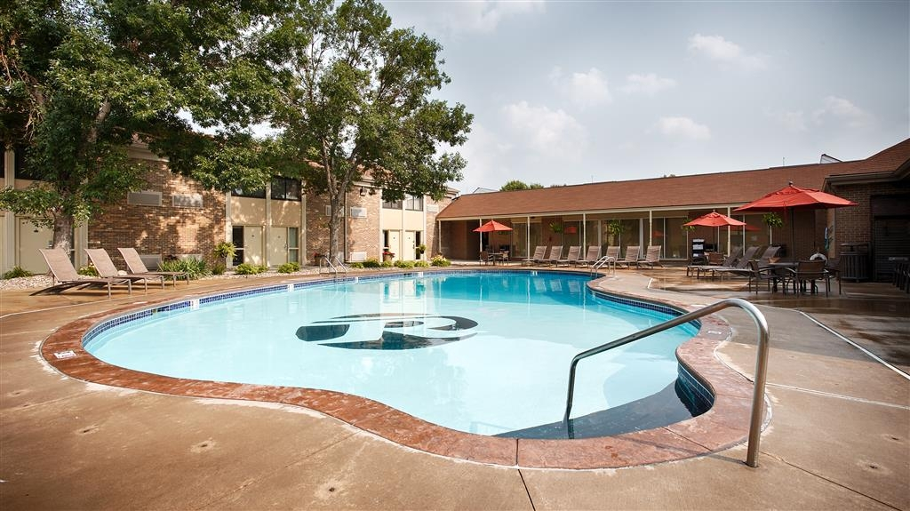 Best Western Plus Ramkota Hotel - Soak up the sun and take in our beautiful landscape while relaxing by our heated Outdoor pool.